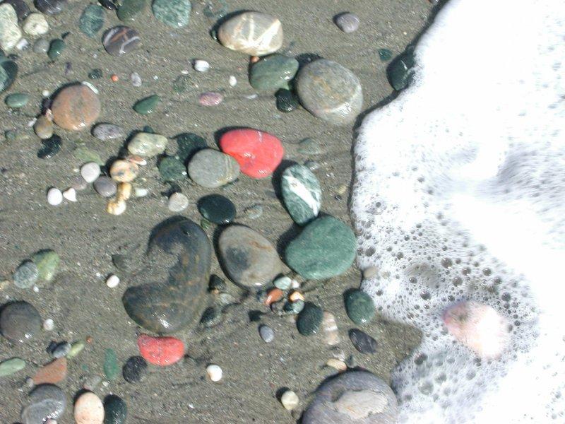 Foam-kissed pebbles
